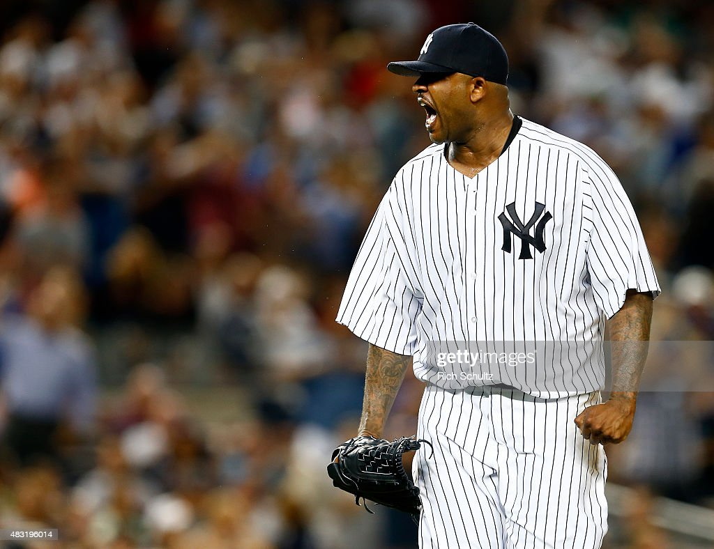 Pitcher CC Sabathia #52 of the New York Yankees reacts after striking out David Ortiz #34 of the Boston Red Sox to end the fifth inning during a MLB baseball game at Yankee Stadium on August 6, 2015 in the Bronx borough of New York City.