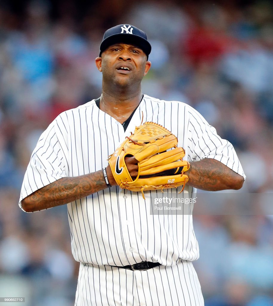 Pitcher CC Sabathia Of The New York Yankees Reacts In An