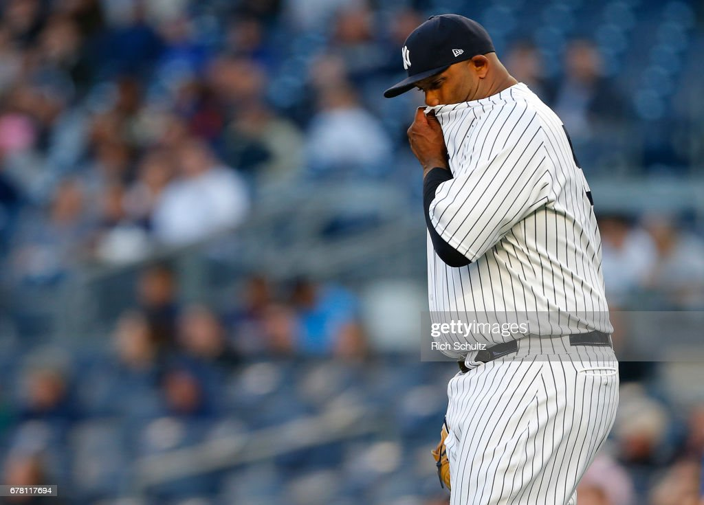 Pitcher CC Sabathia #52 of the New York Yankees reacts to giving up a three-run home run to Steve Pearce #28 of the Toronto Blue Jays during the first inning of a game at Yankee Stadium on May 3, 2017 in New York City.