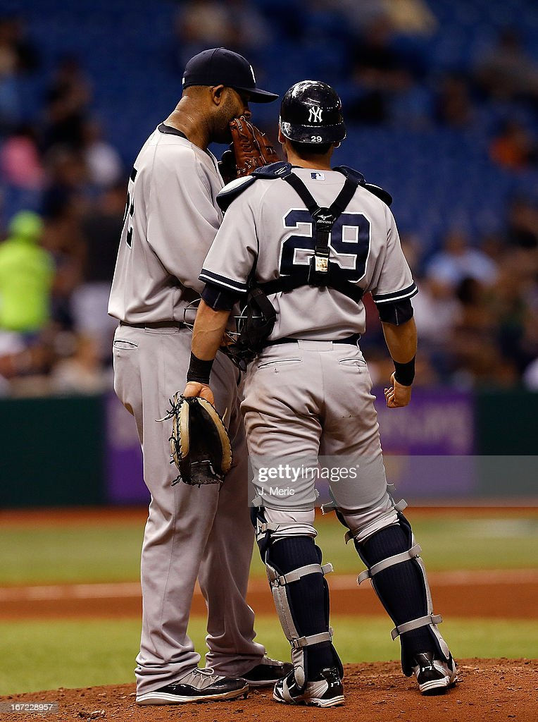 Pitcher C.C. Sabathia #52 of the New York Yankees talks with catcher Francisco Cervelli #29 during the game against the Tampa Bay Rays at Tropicana Field on April 22, 2013 in St. Petersburg, Florida.