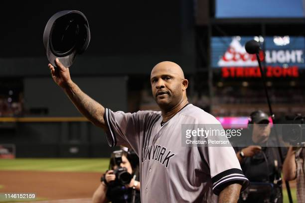 Pitcher CC Sabathia of the New York Yankees waves to the crowd after recording his 3,000th career strike out against John Ryan Murphy of the Arizona...