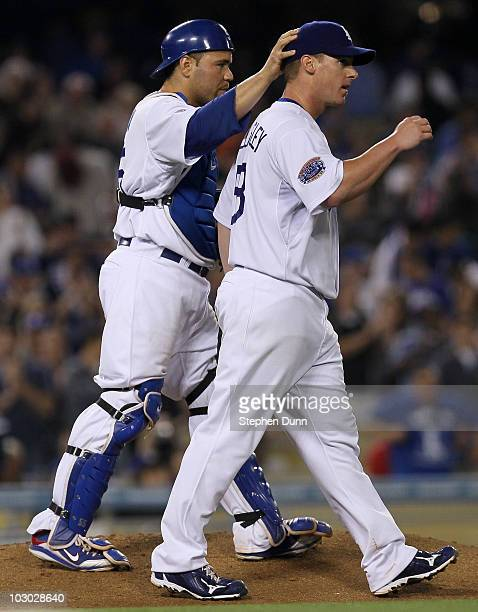 Pitcher Chad Billingsley of the Los Angeles Dodgers is congratulated by catcher Russell Martin after his complete game shutout against the San...