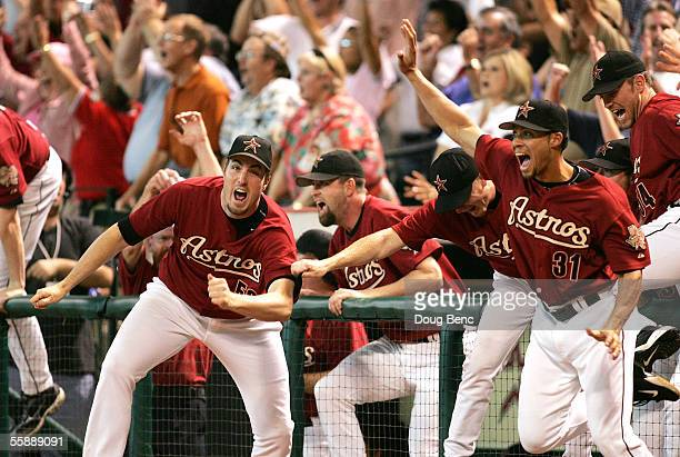 Pitcher Chad Qualls and Charles Gipson of the Houston Astros come out of the dugout to celebrate after Chris Burke hit a solo home run to defeat the...