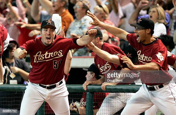 Pitcher Chad Qualls of the Houston Astros and other players celebrate after Chris Burke hit a solo home run to defeat the Atlanta Braves in Game Four...