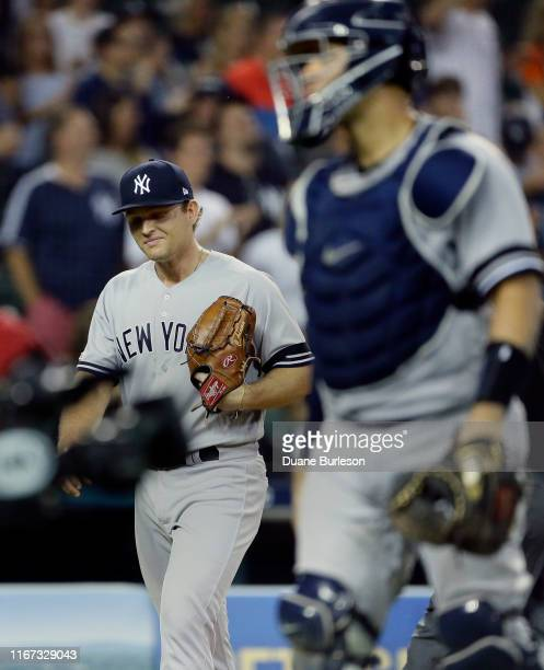 Pitcher Chance Adams of the New York Yankees walks off the field after giving up the game-winning single to Jordy Mercer of the Detroit Tigers during...