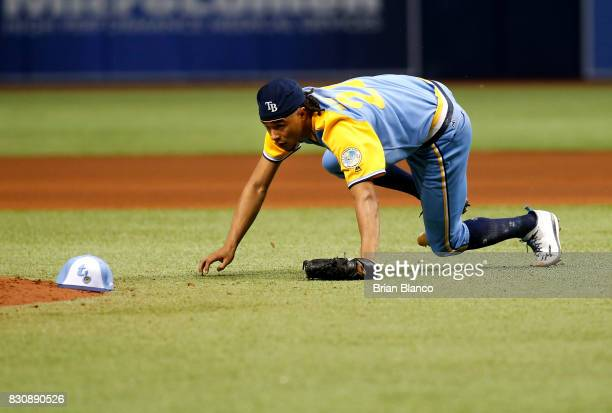 Pitcher Chris Archer of the Tampa Bay Rays gets off the ground after being hit by the single by Giovanny Urshela of the Cleveland Indians during the...