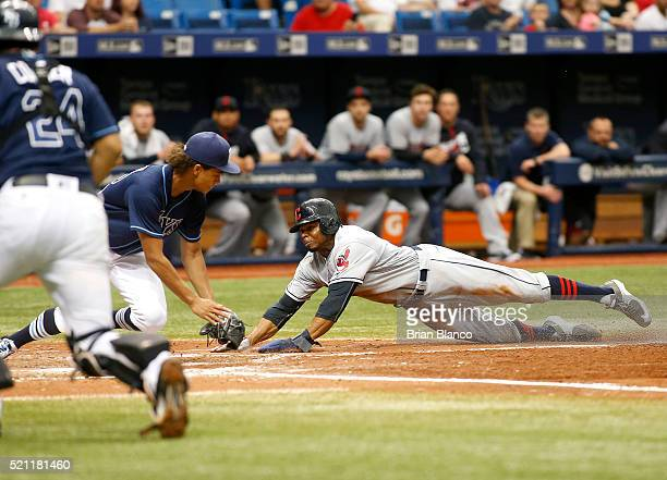 Pitcher Chris Archer of the Tampa Bay Rays gets the out at home plate on Rajai Davis of the Cleveland Indians during the fifth inning of a game on...