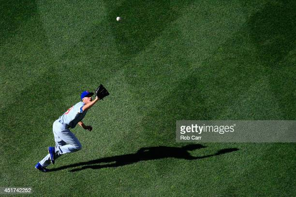 Pitcher Chris Rusin of the Chicago Cubs fields a grounder hit by Denard Span of the Washington Nationals for the third out of the third inning at...