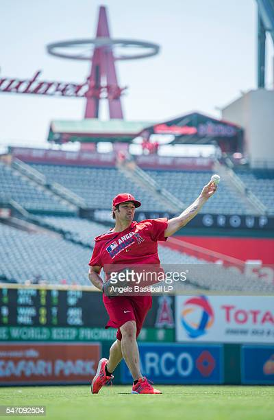 Pitcher CJ Wilson of the Los Angeles Angels of Anaheim throws during warmup before the game against the Oakland Athletics at Angel Stadium of Anaheim...