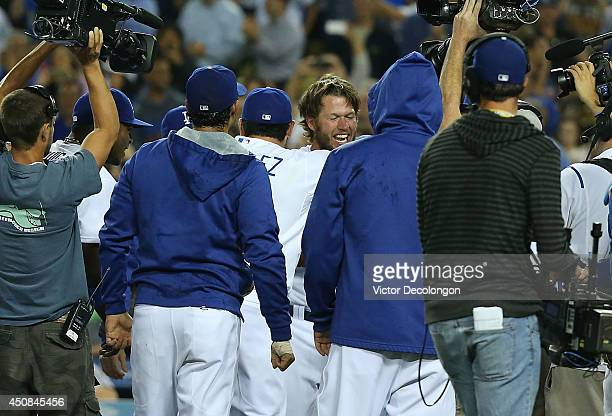 Pitcher Clayton Kershaw of the Los Angeles Dodgers is mobbed by his teammates and television cameramen after Kershaw pitched a nohitter against the...