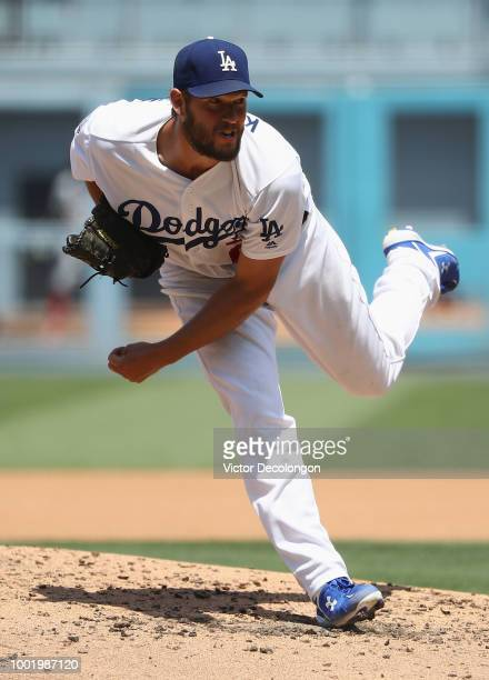 Pitcher Clayton Kershaw of the Los Angeles Dodgers pitches during the third inning of the MLB game against the Los Angeles Angels of Anaheim at...