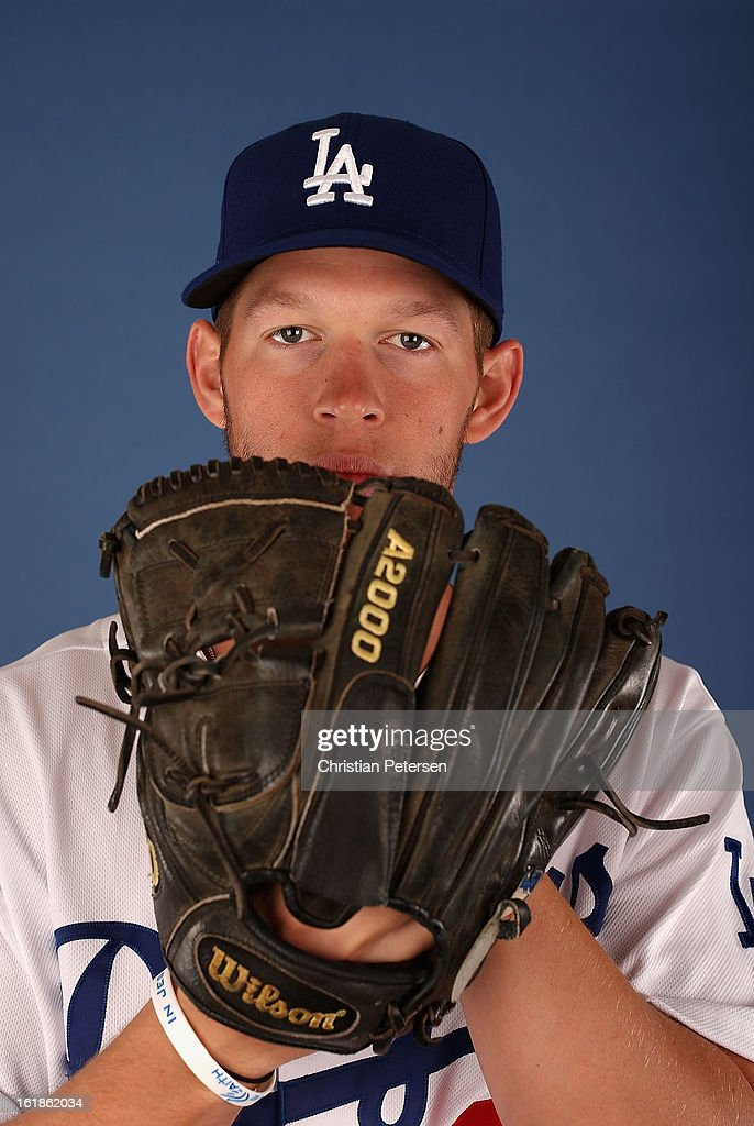 Pitcher Clayton Kershaw #22 of the Los Angeles Dodgers poses for a portrait during spring training photo day at Camelback Ranch on February 17, 2013 in Glendale, Arizona.