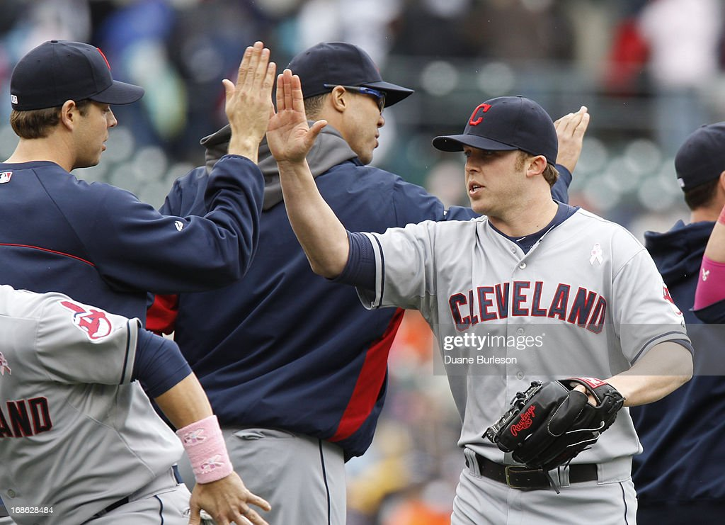 Pitcher Cody Allen #37 of the Cleveland Indians (R) is congratulated by teammates after recording his first save of the season in a 4-3 win over the Detroit Tigers in 10 innings at Comerica Park on May 12, 2013 in Detroit, Michigan.