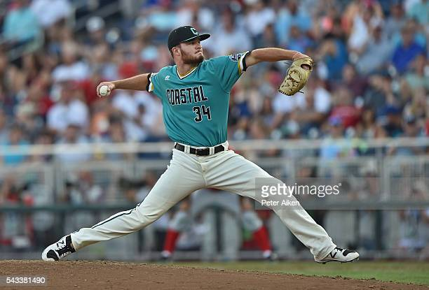 Pitcher Cole Schaefer of the Coastal Carolina Chanticleers delivers a pitch against the Arizona Wildcats in the seventh inning during game one of the...