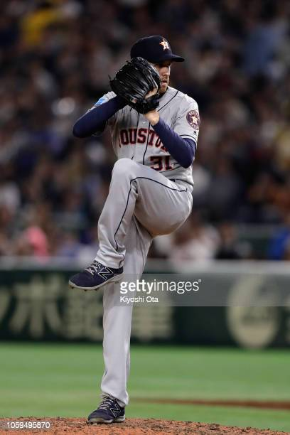 Pitcher Collin McHugh of the Huston Astros throws in the bottom of 7th inning during the game one of the Japan and MLB All Stars at Tokyo Dome on...