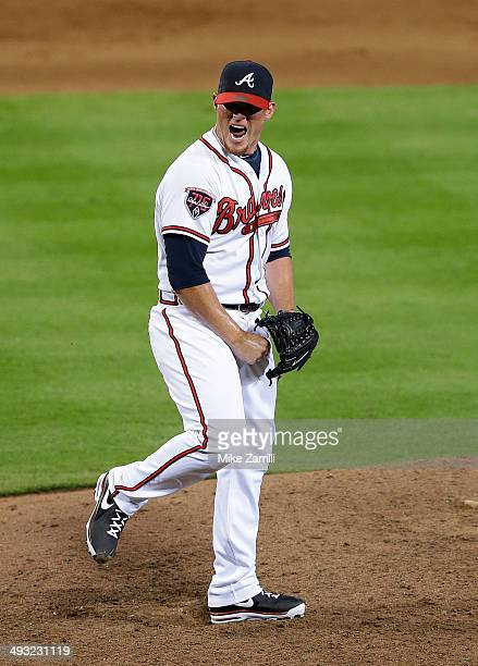 Pitcher Craig Kimbrel of the Atlanta Braves celebrates after the last out of the game against the Milwaukee Brewers at Turner Field on May 22 2014 in...