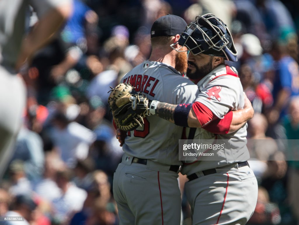 Pitcher Craig Kimbrel #46 of the Boston Red Sox gets a hug from catcher Sandy Leon #3 after striking out Carlos Ruiz of the Seattle Mariners to win the game in the ninth inning at Safeco Field on July 26, 2017 in Seattle, Washington. The Red Sox beat the Seattle Mariners 4-0.
