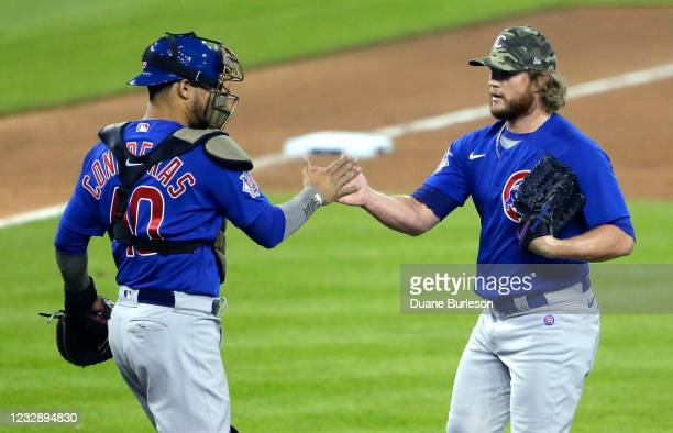 Pitcher Craig Kimbrel of the Chicago Cubs celebrates with catcher Willson Contreras after a 4-2 win over the Detroit Tigers at Comerica Park on May...