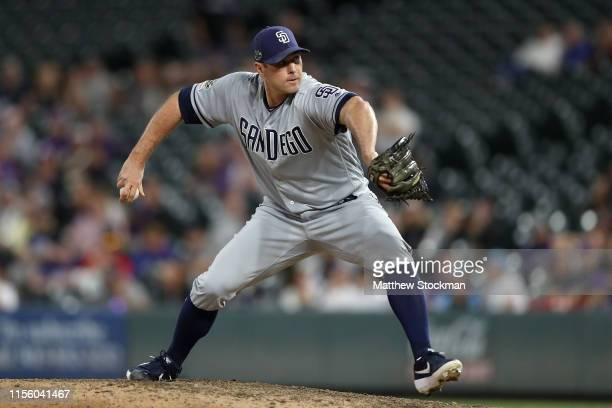 Pitcher Craig Stammen of the San Diego Padres throws in the 11th inning against the Colorado Rockies at Coors Field on June 14, 2019 in Denver,...