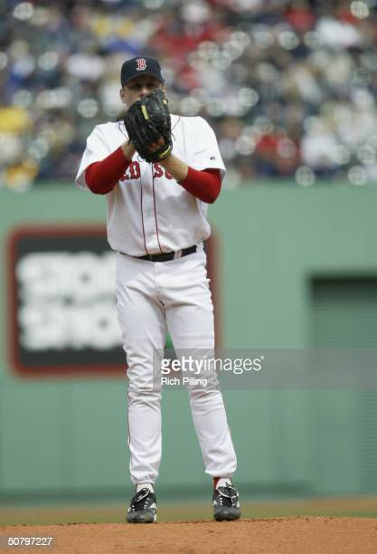 Pitcher Curt Schilling of the Boston Red Sox on the mound during the game against the Toronto Blue Jays at Fenway Park on April 11 2004 in Boston...