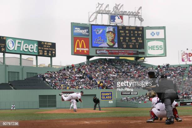 Pitcher Curt Schilling of the Boston Red Sox pitches to Carlos Delgado of the Toronto Blue Jays during the game at Fenway Park on April 11 2004 in...