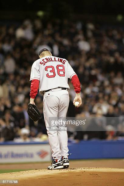 Pitcher Curt Schilling of the Boston Red Sox stands on the mound during game one of the ALCS against the New York Yankees at Yankee Stadium on...