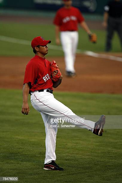 Pitcher Daisuke Matsuzaka of the Boston Red Sox kicks up his leg after giving up a hit against Boston College during a Spring Training game on March...