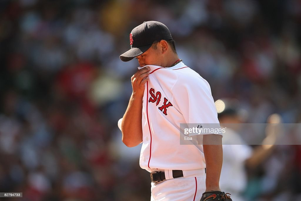 Pitcher Daisuke Matsuzaka #18 of the Boston Red Sox wipes the sweat with his jersey during the MLB game against the Baltimore Orioles on September 3, 2008 at Fenway Park in Boston, Massachusetts.