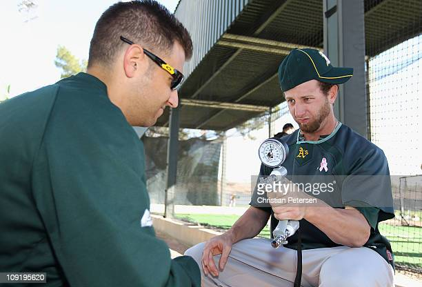Pitcher Dallas Braden of the Oakland Athletics participates in a hand strength drill during a MLB spring training practice at Phoenix Municipal...