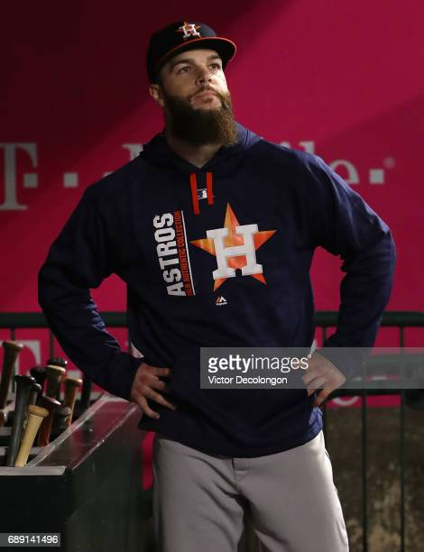 Pitcher Dallas Keuchel of the Houston Astros looks on from the dugout shortly after leaving the game in the bottom of the ninth inning during the MLB...