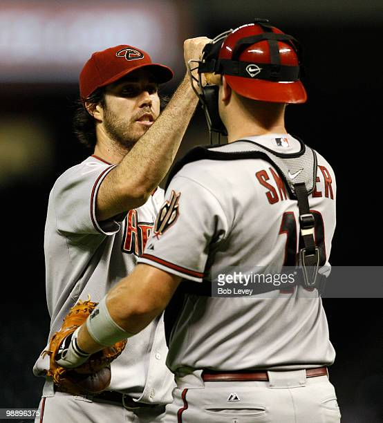 Pitcher Dan Haren of the Arizona Diamondbacks gets a high five from catcher Chris Snyder after the final out against the Houston Astros at Minute...