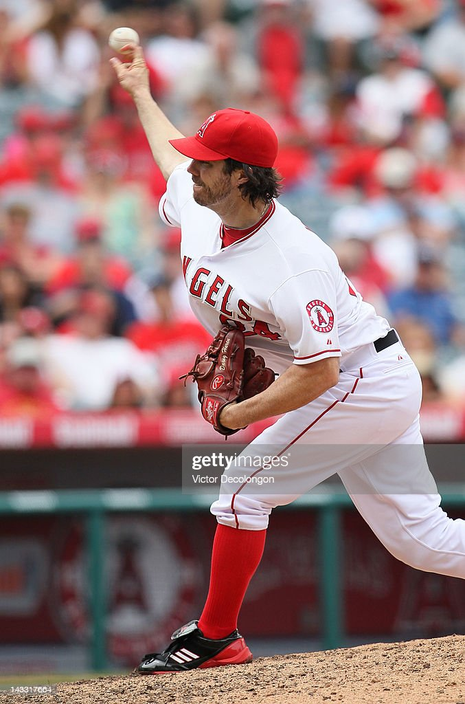Pitcher Dan Haren #24 of the Los Angeles Angels of Anaheim pitches during the MLB game against the Baltimore Orioles at Angel Stadium of Anaheim on April 22, 2012 in Anaheim, California. The Orioles defeated the Angels 3-2 in ten innings.