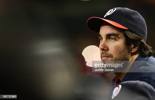 Pitcher Dan Haren of the Washington Nationals watches the game against the Arizona Diamondbacks from the dugout at Chase Field on September 27 2013...