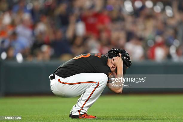 Pitcher Dan Straily of the Baltimore Orioles reacts after allowing a two-run home run to Michael Chavis of the Boston Red Sox during the fifth inning...