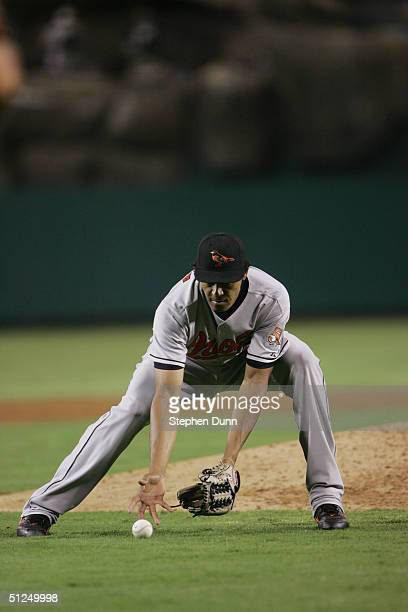 Pitcher Daniel Cabrera of the Baltimore Orioles fields the ball during the game against the Anaheim Angels on August 10, 2004 at Angel Stadium in...