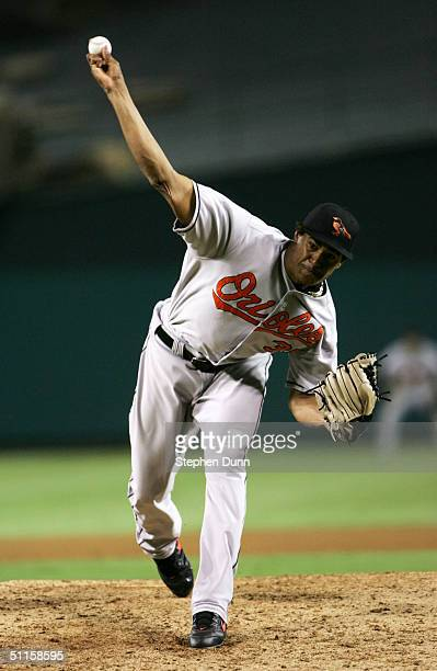 Pitcher Daniel Cabrera of the Baltimore Orioles throws a pitch against the Anaheim Angels on August 10, 2004 at Angel Stadium in Anaheim, California.