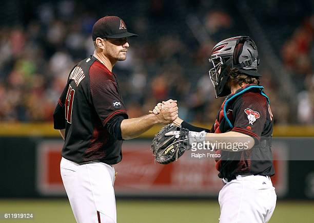 Pitcher Daniel Hudson of the Arizona Diamondbacks is congratulated by catcher Tuffy Gosewisch after a 95 victory against the San Diego Padres during...