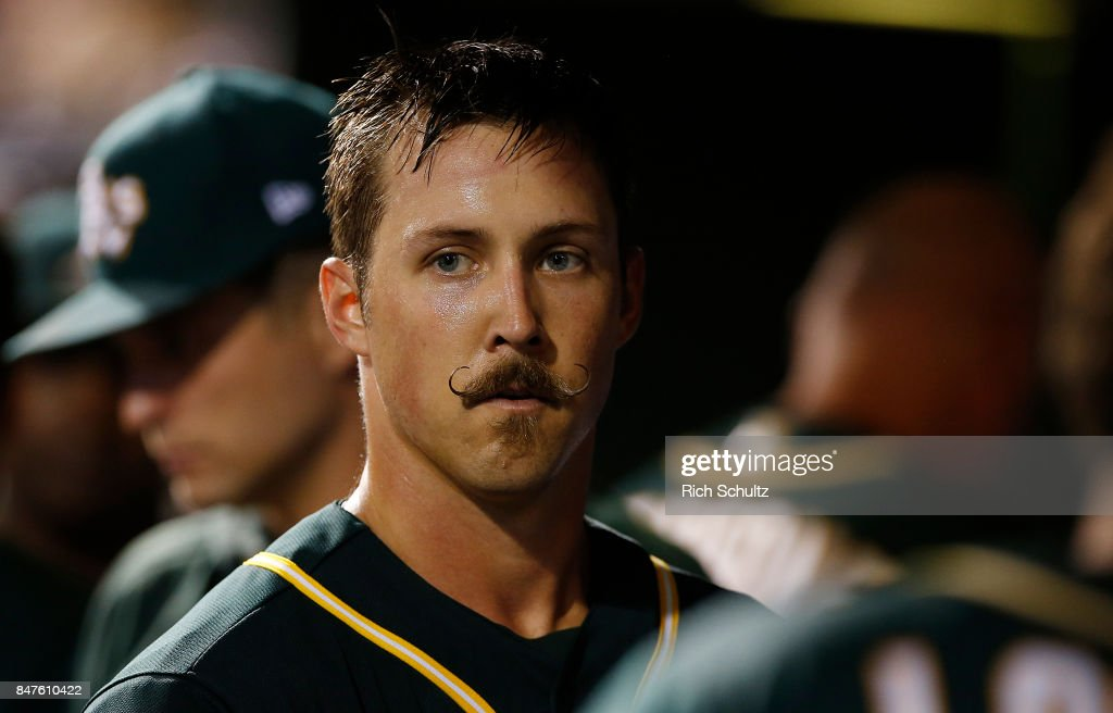Pitcher Daniel Mengden #33 of the Oakland Athletics in the dugout after he pitched the eighth inning against the Philadelphia Phillies during a game at Citizens Bank Park on September 15, 2017 in Philadelphia, Pennsylvania. Mengden pitched a two-hit complete game shutout as the A's defeated the Phillies 4-0,