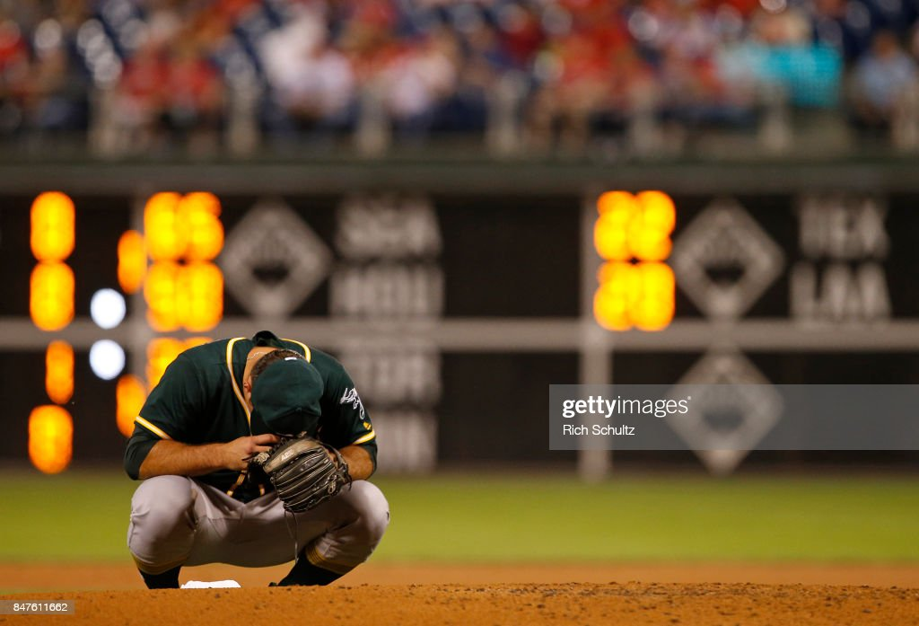 Pitcher Daniel Mengden #33 of the Oakland Athletics prays before making his first pitch during the first inning against the Philadelphia Phillies during a game at Citizens Bank Park on September 15, 2017 in Philadelphia, Pennsylvania. Mengden pitched a two-hit complete game shutout as the A's defeated the Phillies 4-0,