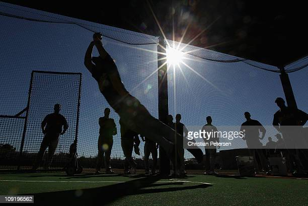 Pitcher Danny Farquhar of the Oakland Athletics participates in a jumping drill during a MLB spring training practice at Phoenix Municipal Stadium on...