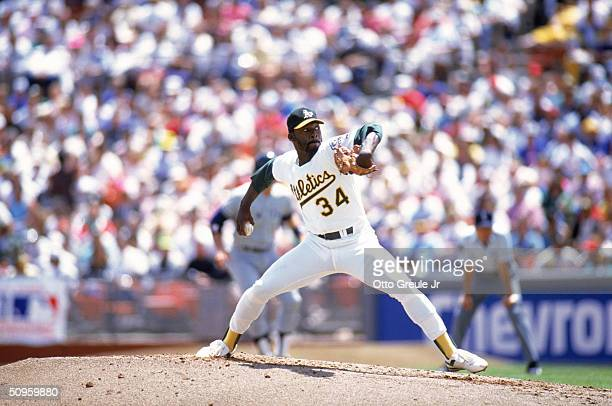 Pitcher Dave Stewart of the Oakland Athletics delivers a pitch during a game against the New York Yankees in the 1990 season at Oakland Alameda...