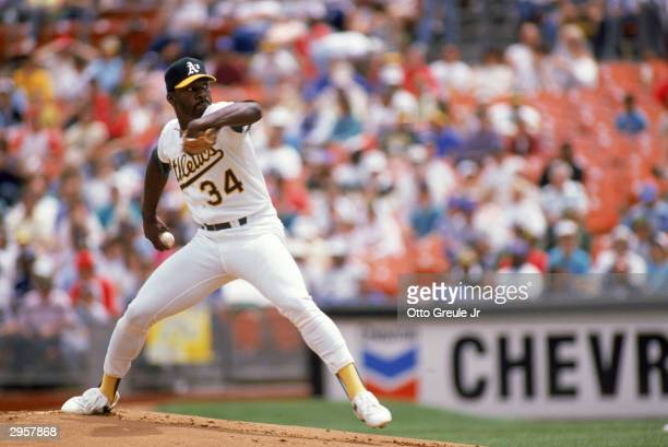 Pitcher Dave Stewart of the Oakland Athletics prepares to deliver the ball during a 1989 American League season game at the OaklandAlameda County...