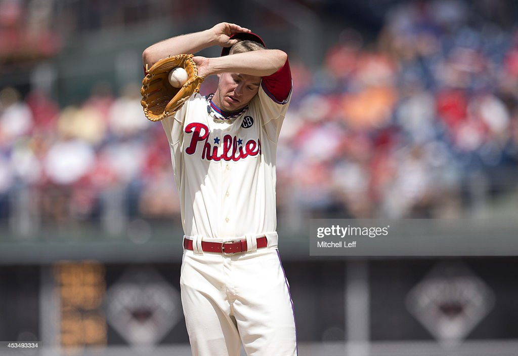 Pitcher David Buchanan #55 of the Philadelphia Phillies wipes the sweat off his forehead in the top of the fifth inning against the New York Mets on August 11, 2014 at Citizens Bank Park in Philadelphia, Pennsylvania.