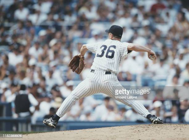 Pitcher David Cone of the New York Yankees pitching the perfect game during the Major League Baseball American League East game against the Montreal...
