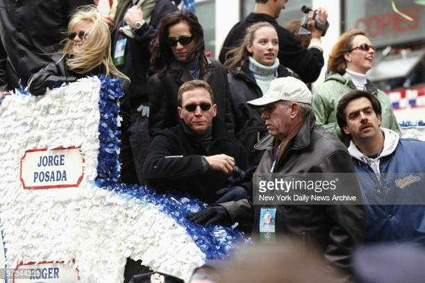 Pitcher David Cone rides on float carrying the World Champion New York Yankees up Broadway through the Canyon of Heroes during a ticker tape parade...