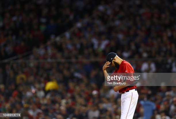 Pitcher David Price of the Boston Red Sox reacts in the second inning of Game Two of the American League Division Series against the New York Yankees...