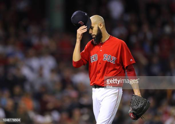 Pitcher David Price of the Boston Red Sox takes his hat off as he walks back to the dugout after being pulled from the game in the second inning of...