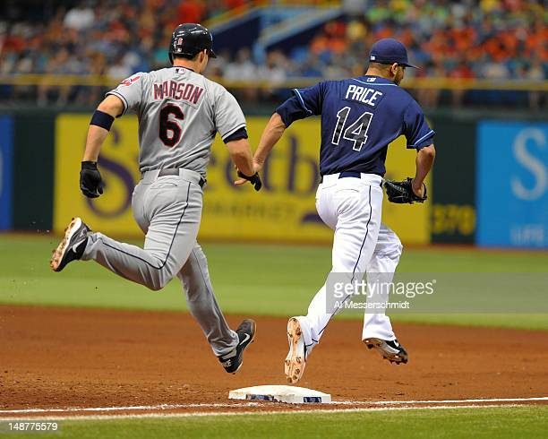 Pitcher David Price of the Tampa Bay Rays beats catcher Lou Marson of the Cleveland Indians for an out July 19 2012 at Tropicana Field in St...