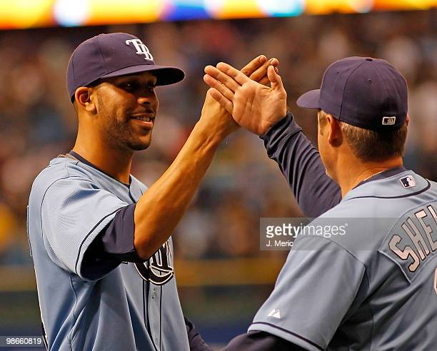 Pitcher David Price of the Tampa Bay Rays is congratulated by hitting coach Derek Shelton after his complete game shutout against the Toronto Blue...