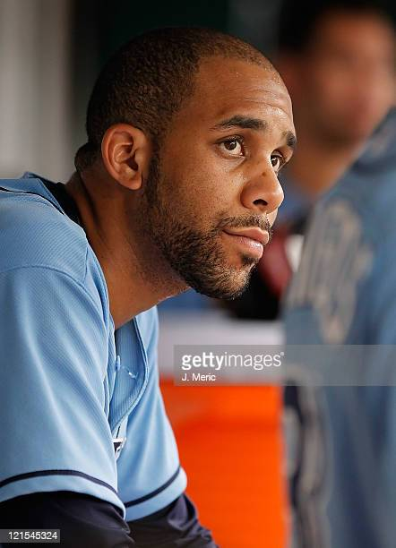 Pitcher David Price of the Tampa Bay Rays watches his team from the dugout against the Oakland Athletics during the game at Tropicana Field on August...